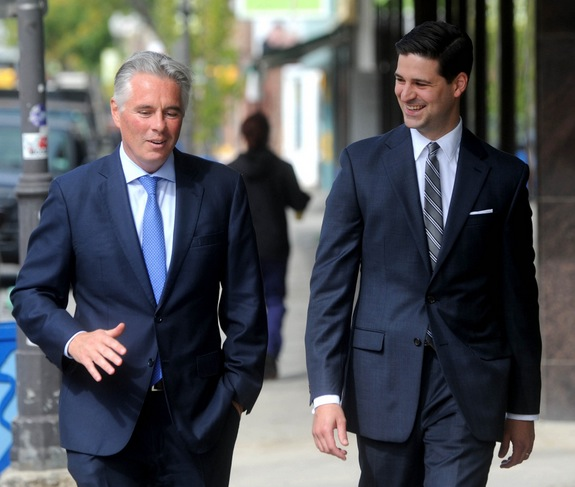 Colby College President David A. Greene and Waterville Mayor Nick Isgro walk down Main Street in downtown Waterville on Tuesday. photo by Michael G. Seamans